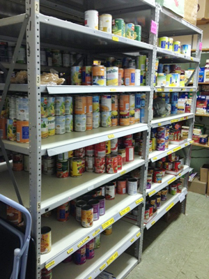 Shelving with cans of food.